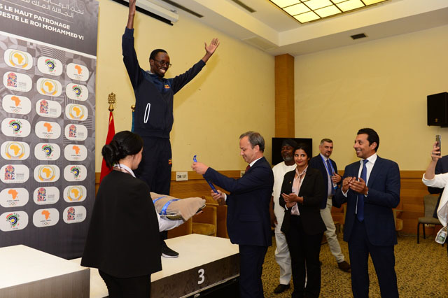 Harold Wanyama about to receive his bronze medal from FIDE President Arkady Dvorkovich. FIDE Vice President Mohamed Al-Modiakhi looks on. Photo by Mohamed Bounaji/FIDE