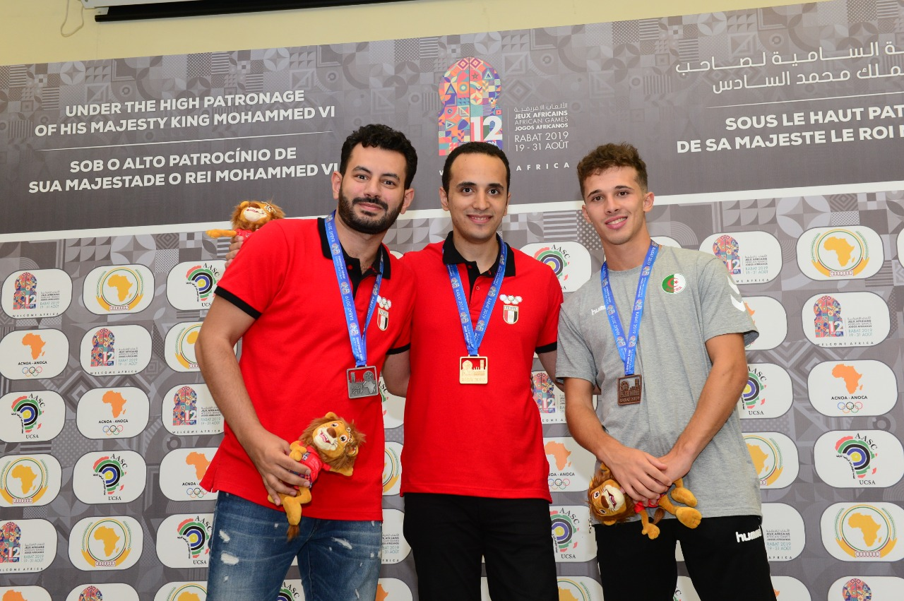 Ahmed Adly (Egypt), Bassem Amin (Egypt), Bilel Bellahcene (Algeria) at 2019 Africa Games taking 1-2-3 in the blitz competition. Photo by Mohamed Bounaji.