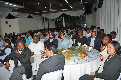 Audience at dinner awaiting Anand speech.