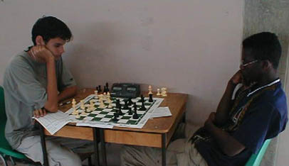 Allan Munro (TRI) vs. Justin Kirton (BAR) in a crucial  7th round match. Copyright © 2002, Barbados Chess Federation.