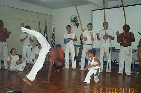 Young capoeirista accepts the challenge. Copyright © 2005, Daaim Shabazz.