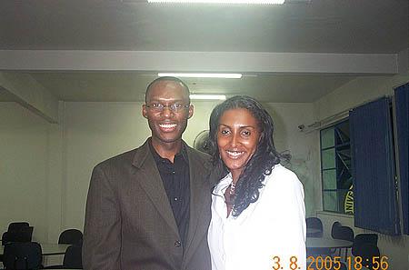 Daaim Shabazz poses with TV1 reporter, Viviane.. Copyright © 2005, Daaim Shabazz.