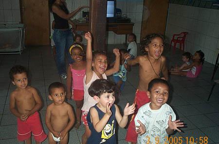 Children cheering each flash of camera. Copyright © 2005, Daaim Shabazz.