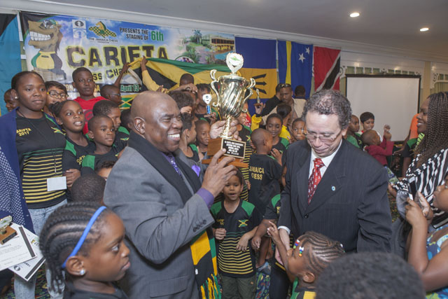 Ian Wilkinson accepts team trophy for Jamaican team!