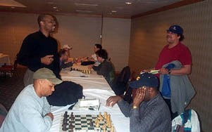 Frank Johnson (seated left) blitzing with Kent Williams while John Porter (standing left) chats with Tyrone Lee. Copyright © 2003, Daaim Shabazz