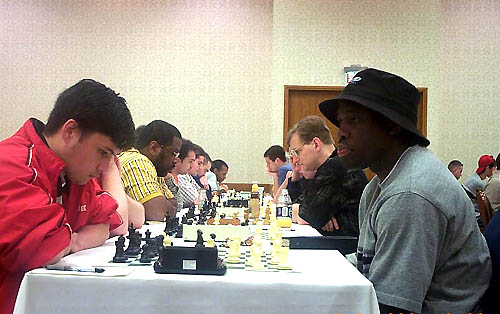 IM Oladapo Adu (right) facing off against 18-year old NM William Aramil. Copyright © 2004, Daaim Shabazz