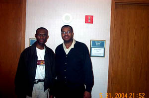 The Chess Drum's Dr. Daaim Shabazz with Lawyer Times. Times won clear 2nd in the under-2200 section. Copyright © 2004, Daaim Shabazz
