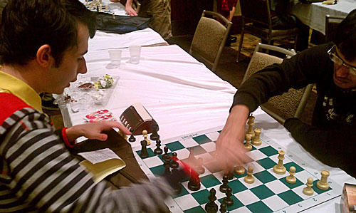 Aleksandr Lenderman analyzing with Pentala Harikrishna. Harikrishna won.