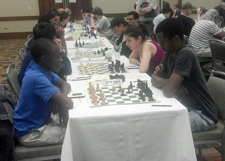 NM Josh Colas vs. Farai Mandizha. Photo by Guy Colas.
