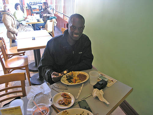 I know, I know... you eat Ethiopian food with your hands, but we ran out of injera bread! :-) It was on the way, but I couldn't wait. Photo by Daaim Shabazz.