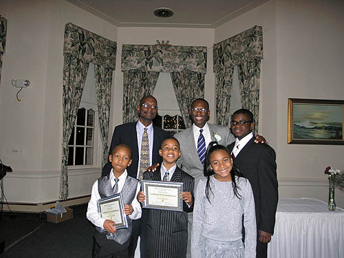 Kenneth Morris, Daaim Shabazz and Kayin Barclay pose with DCCC youth.
