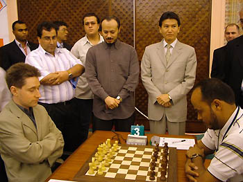 Nizar Elhaj, Mohammed Al Gadhafi and Kirsan Ilyumzhinov before the ceremonial 1st move of the championship. Photo courtesy of FIDE.com.