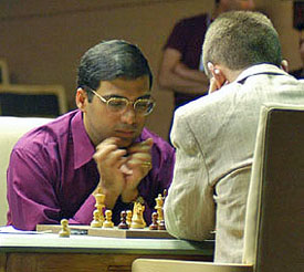 Anand-Adams in action. Adams seems to be plugging his ears from all the fireworks exploding around his king.