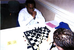Okechukwu Iwu scored 6/7 to tie for 1st in the U2200 section. Here he defeats Ben Johnson in his 6th round encounter. Copyright © 2002, Daaim Shabazz.