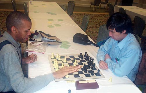 IM blitz clash! Stephen Muhammad vs. Bobby Kurniawan. Copyright © Daaim Shabazz, 2003.