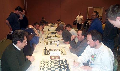 The Short Schedule: GMs Igor Novikov and Ilya Smirin have already agreed a quick draw while IM Amon Simutowe—GM Alexander Goldin have just begun. Copyright © Daaim Shabazz, 2003.