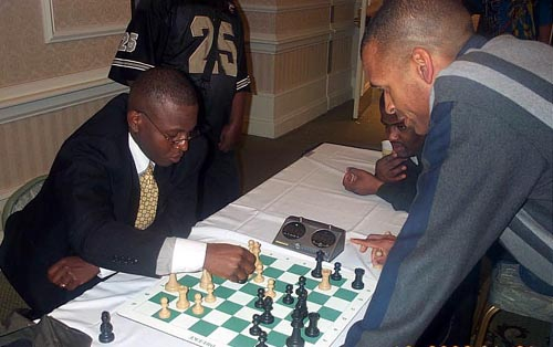 Sylvester Smarty vs. Muhammad in midnight blitz battle... the results were not encouraging for Smarty. Copyright © Daaim Shabazz, 2003.