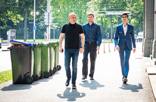 Sergey Karjakin and Anish Giri walking with Giri's trainer Vladimir Chuchelov