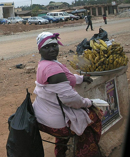 Vendor selling bananas. I was intrigued by these women who not only balance heavy load on their heads, but they were adept and dismantling their wares and serving quickly.