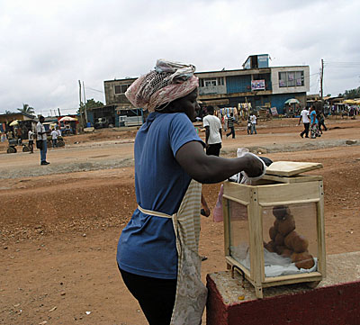 Woman selling the Ghanaian version of fried dough or