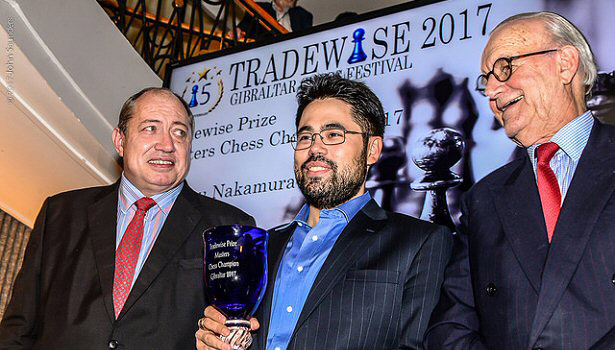 Hikaru Nakamura receives his winners cheque for £23,000 and trophy from Tradewise Chairman James Humphreys (left) and Tradewise Chess Festival Organiser Brian Callaghan. Hikaru scored 8/10 (+6,=4) and then won a playoff 1½-½ to take first prize. Photo © John Saunders