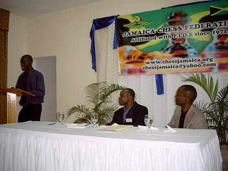 Amon Simutowe presenting an interesting lecture in Kingston, Jamaica about his chess beginnings and experiences. Ian Wilkinson (center) was the moderator and Daaim Shabazz had spoken earlier about The Chess Drum and chess psychology. Copyright © 2004, Mark Bowen.