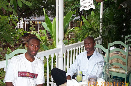 Daaim Shabazz and International Master Amon Simutowe relaxing in Kingston, Jamaica. The six-day excursion is the subject of a photo essay recounting the activities day-by-day.