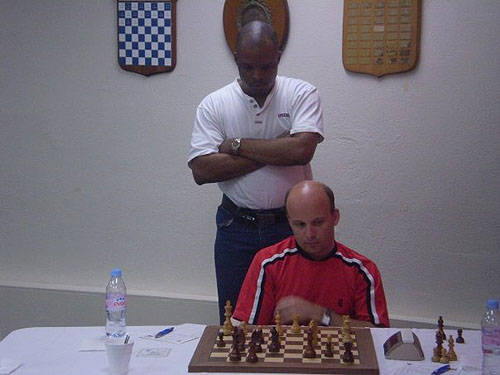 Barbados' Denny looking from opponent's perspective. Appears to be the final position so a draw was accepted. Neubauer ponders next move. Photo by Dirk Austin.
