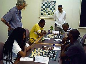 Ras Malaku Lorne vs. Warren Elliott (front) and Daren Wisdom vs. Mark Holness (back). Copyright © 2004, Mark Bowen