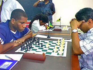 National Master Duane Rowe (left) makes his move against FIDE Master Warren Elliott, in the feature match of round 1 of the 2005 LASCO Chess Championships on Sunday. The match ended in a draw.