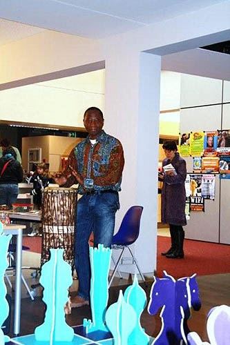 An African drummer in the Netherlands gives blessings to the match.