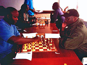 Ateka left and Makatia right in a tension packed game. Copyright © Alex Makatia, 2005.