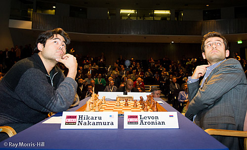 Both Nakamura and Aronian glances up at the display boards. Photo by Ray Morris-Hill.