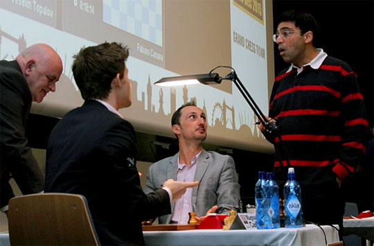 Carlsen explains to Anand why he took the pawn with 84. Nxe5. Photo by Amruta Mokal.