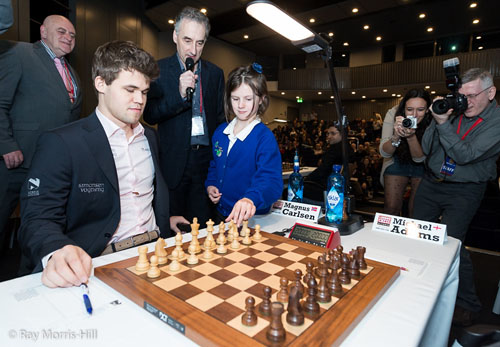 Girl plays 1.Nc3 for ceremonial move. Would Carlsen keep that move? Photo by Ray Morris-Hill.