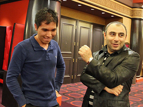 GM Varuzhan Akobian helping Wesley So celebrate. Photo by Daaim Shabazz.