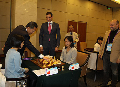 Hou Yifan (China) and Zhao Xue (China) set to face off after ceremonial moves.