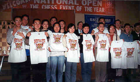 The Chinese National Team receiving gifts from the U.S. Chess Federation. Copyright © 2003, Daaim Shabazz