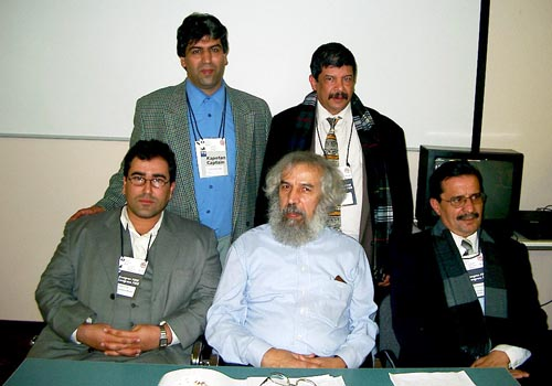 Representatives of Zone 4.1 pose after the African Continental Meeting. Seated at left and in the center are Nizar Ali Elhaj and Lakhdar Mazouz, respectively, the incoming and outgoing African Continental Presidents. Copyright © Jerry Bibuld, 2002.