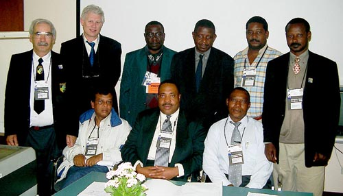 Representatives of Zone 4.3 pose after the African Continental Meeting. Seated in the center is Lewis Ncube, incoming Zonal President. Copyright © Jerry Bibuld, 2002.