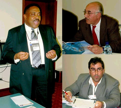 Candidates for African Continental President. (clockwise) Lewis Ncube (Zambia), GM Slim Bouaziz (Tunisia), Nizar Elhaj (Libya).  Copyright © Jerry Bibuld, 2002.