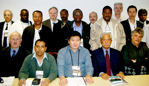 Some of participants in the CACDEC meetings. Standing directly in the center is Daniel Nsibambi (Uganda). Standing second from the right is Allan Herbert (Barbados), who was named Co-Chairman of CACDEC. Copyright © Jerry Bibuld, 2002.