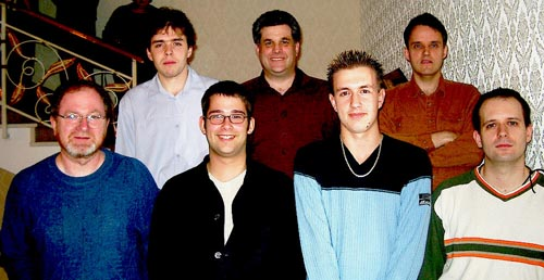 Canadian Players (front row, left to right) GM Kevin Spraggett (Bd. 2), IM Pascal Charbonneau (Bd. 3), IM Mark Bluvshtein (Bd. 5), GM Alexander Lesiege (Bd. 1); (back row, left to right) IM Yan Teplitsky (Bd. 4), Sid Belzberg (captain), IM Jean Hebert (Bd. 6). Copyright © Jerry Bibuld, 2002.