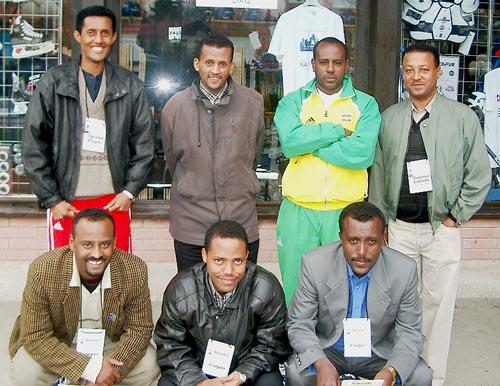 Ethiopia's Men's Team. (kneeling, from left to right) are Dewit Wondimu (Bd. 1), Fikreselassie Alemu (Bd. 2), Yimam Abera (Bd. 3); standing (from left to right) Abenet Bekele (Bd. 4), Mekitu Molla (Bd. 5), Wossenyelew Hailu (Bd. 6) and the Team Captain, Tsega Kumlachew. Copyright © Jerry Bibuld, 2002.