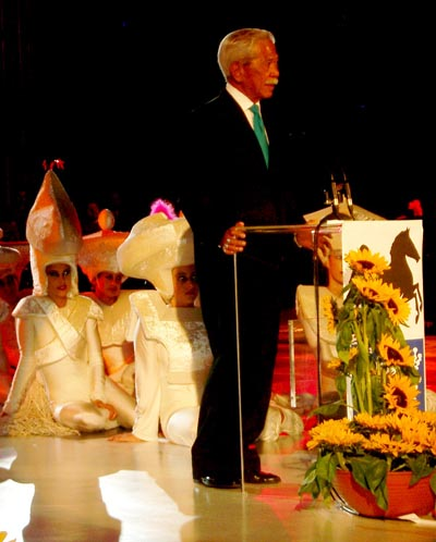 Florencio Campomanes, Honorary President of FIDE, reading the greetings of President Iljumzhinov to those at the Opening Ceremonies. Copyright © Jerry Bibuld, 2002.