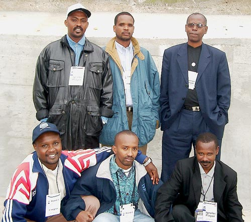 Rwanda's Men's Team (kneeling, left to right) Fidele Mutabazi (Bd. 1), Maxence Murara (Bd. 2) and Johnson Rutayisire (Bd. 3); standing (left to right) Rugema Ngarambe (Bd. 4), Chrisotpher Karenzi (Bd. 5) and Edison Niyongereye (Bd. 6 and Captain). Copyright © Jerry Bibuld, 2002.