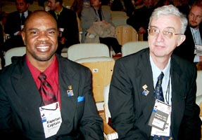 Ian Wilkinson (JAM), Captain of both teams, at left; Robert Wheeler (JAM), secretary of the JAM Chess Federation, player, and FIDE delegate. Copyright © Jerry Bibuld, 2002.