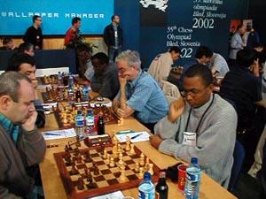 Jamaican Men in Round #1. (top L-R) FM Warren Elliott, Duane Rowe, Robert Wheeler, Mark Smith. Copyright © Barbados Chess Federation, 2002.