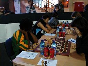 Jamaican Women in Round #1 (L-R) Deborah Richards, Zhu Hui, Vanessa Thomas. Copyright © Barbados Chess Federation, 2002.