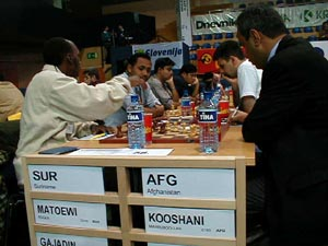 Suriname vs. Afghanistan (Men). Copyright © Barbados Chess Federation, 2002.